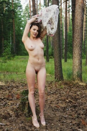 Ukrainian gal chooses a secluded place in the forest and starts playing with twat
