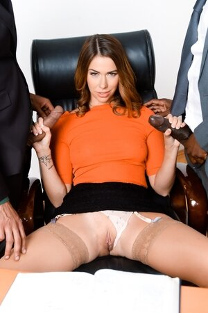 Young business lady stuffed with white and black cock at the same time
