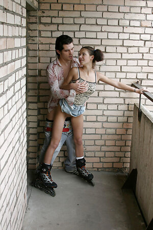 Russian schoolgirl with two pigtails lets guy pound her on the public balcony