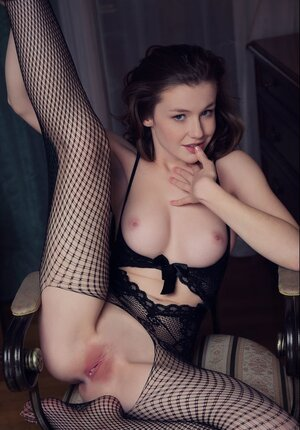 Excited Ukrainian kitten wears a black bodystocking with a hole for her pussy