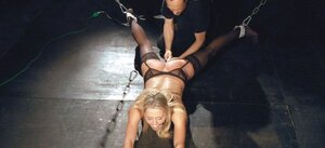 Blonde gal in stockings sucks master's dick after he pours body with hot wax