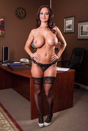 Businesslike female in black stockings brags about amazing curves in office