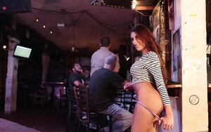 Chick with hot face and plus natural tits does mind blowing strip in the pub