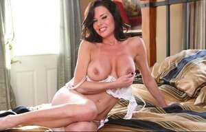 Smoking hot black-haired dame performs amazing strip show in her bedroom