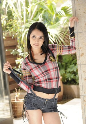 Attractive Asian female Maria Ozawa goes outdoors to pose seductively on terrace