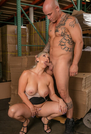 Serbian blonde with massive knockers gives head to bald warehouse worker