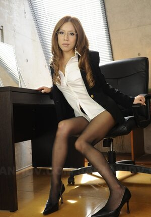 18-19 year old sexy oriental office girl shows underwear she is wearing at work