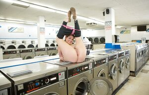 Good-looking housewife loads washing machine and has some time for obscene things
