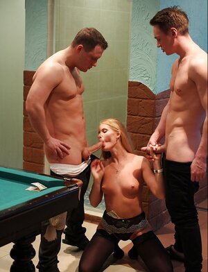Hot model with nude boobs blows off a couple of dicks on the knees by the pool table