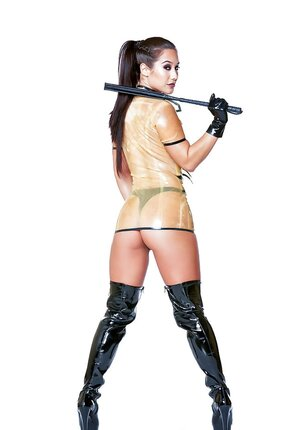 Dangerous vixen Eva Lovia in latex outfit, panties, high boots and also with a whip