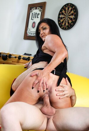 Sexually available mom demonstrates huge breasts tempting man into making it with her