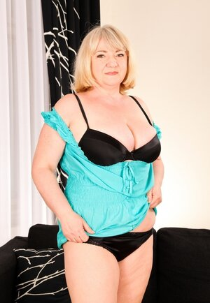 Aged Adult bbw takes off clothes to show body covered in sexy black lingerie
