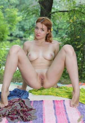 Teenage with red hair and furthermore besides juicy eyes ready to seduced fans with tits and furthermore besides cum bucket