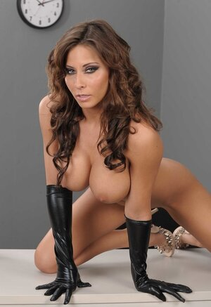 Gorgeous Eager mom in leather corset and long gloves takes her round big tits to light