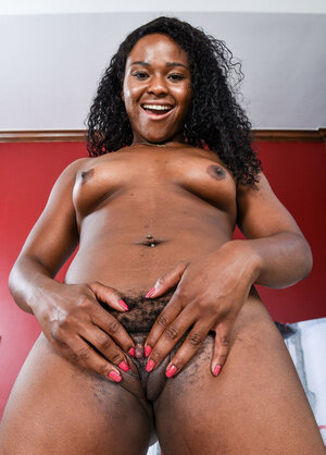 Perverted Ebony whore has to share her hairy cunt spreading the labia