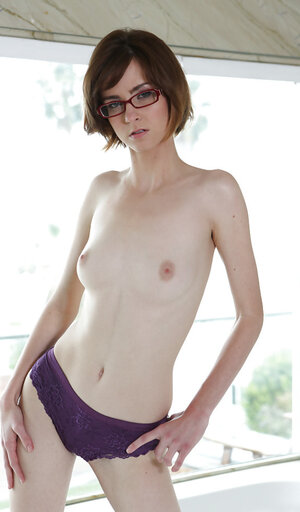 Debauched lady with glasses exposes her pale body and bushy cherry