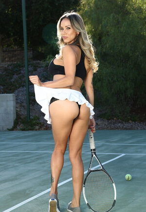 Latina in top and besides short skirt thinks tennis court is a good place to show tits